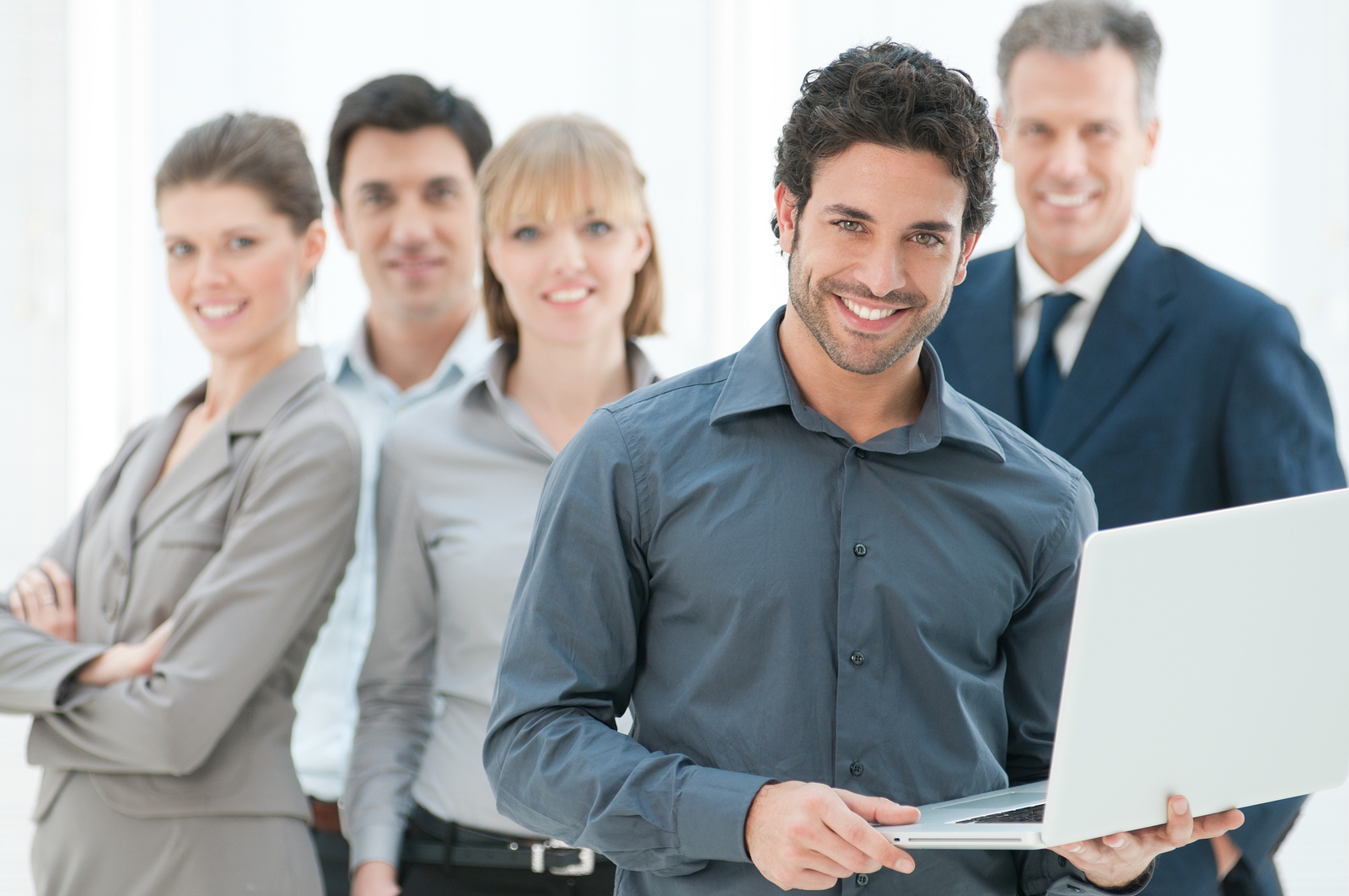 bigstock-Happy-business-man-holding-a-m-33012347